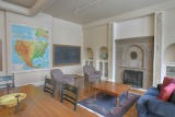 Chalk boards and a large map keep the schoolroom theme inside a residence in Myrtle Hill Lofts, a...
