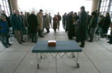 0026 The ashes of 10th Mountain Division's loyd O. Yorker remain on a table as his memorial...