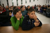 Yolanda Chacon (cq) and her son Cesar A. Montes, 10, (cq) of Denver react after hearing the wrong...