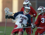 Kent Denver's Alex Langhorne (left #3) moves the ball towards Kent's goal beind defended by Cherry...