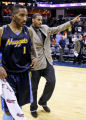 (SPECIAL TO THE ROCKY MOUNTAIN NEWS) Denver Nuggets player Carmelo Anthony (L) and J.R. Smith (1)...