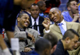 (SPECIAL TO THE ROCKY MOUNTAIN NEWS) Denver Nuggets player Carmelo Anthony (L) sits on the bench...
