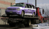 A tow truck hauls a Freedom cab from 56th and Pena to the Denver Impound lot  January 28, 2009. ...