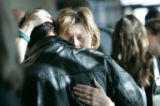 0008 Dottie Shannon is given hundreds of hugs before and after a memorial service to celebrate her...