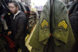 SR(0179) Shane Ballard, 35, of Aurora browses the camouflage selection at the Arvada Army Navy...