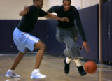 (PG17040) The Nuggets' Carmelo Anthony practices on Thursday, January 29, 2009 with assistant...
