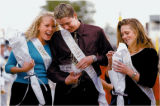 Patrick Ireland, center, is congratulated by Amy Bierbach, left, and escort Tamara Pollard, right,...