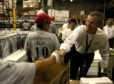 (Denver, Colo., June 14, 2004) EchoStar CEO Charlie Ergen shakes hands with employees at a Denver,...