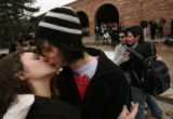 038  University of Colorado at Boulder students, Maddie Jones (cq), left, kisses Kevin Woods (cq)...
