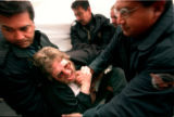 RMN305-5-1-99--NRA PROTEST- Sam Myrant is removed by Denver Police officers from an anti-NRA...