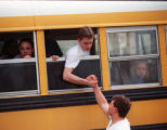 RMN186-4-20-99-Denver,Co. -A rescued student reaches out of a school bus window outside of...
