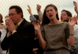 RMN 200 5-2-99 Youth pastor Anthony Langston of Landmark Tabernacle prays along with other Sunday...