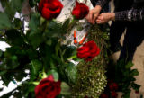 (PG0601) Freelance floral designer Jan DesMarteau (cq) works on arrangements for Valentine's Day...