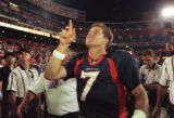 (DENVER, COLO., SEPTEMBER 7, 1998) Denver Broncos quarterback John Elway points up to a fan after...