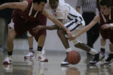 #15 Terrance Brockman (cq) of Denver Lutheran loses the ball against #4 Joel Hegarty (cq) and #11...