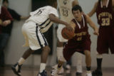 #4 Joel Hegarty of Faith Christian reaches for the ball against #15 Terrance Brockman (cq) of...