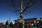 13-year-old Kyle Fischer (cq) leans on a tree at a parking lot where over a hundred bike riders...