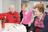 Stott Elementary 2nd grader, Brea Gibson center, shares a story with Springwood residents, George...