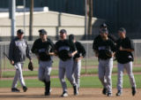 (0039) Clint Hurdlw watches as Colorado pitchers jog past during Colorado Rockies spring training...