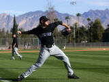 (0028) Ryan Mattheus warms up his arm during Colorado Rockies spring training at Hi Corbett Field...