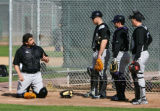 (0146) Sal Fasano, left, talks with his fellow catchers at Colorado Rockies spring training at Hi...