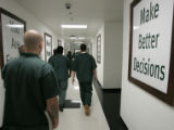 """Residents"" pass for classes at the Cheyenne Mountain Re-Entry Center, a medium security..."