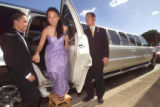 20030319 FTR LIMO 09 Justin Perez helps Trissa Ogata out of the limo while limo driver, Don Hyeon...