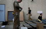 (PG0958) Namaste Solar workers (from left) Sam Mason, Jason Houston, and Jon Ernst assemble a...