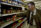 Paul Sandlin of Den. grabs a jar of peanut butter at the King Soopers in Denver, Colo. Monday...