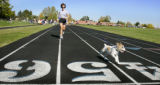 "Michelle Marchildon (cq) and her dog Maisy (cq) , runs a lap in the  ""Run 4 Relief Family..."