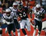 JPM0228 Denver Broncos running back Tatum Bell, #26, pulls away from New England Patriots...