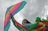 0105 Amanda Slovich flies a kite with her boyfriend as they prepare for a great week of warm...
