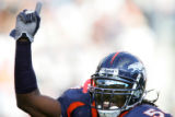 Denver Broncos Patrick Chukwurah pumps up the crowd as the second half gets underway as the...