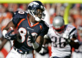 Rod Smith runs with the ball for a 72 yard reception in the second quarter of the New England...