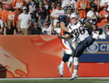 John Lynch breaks up a pass intended for Tim Wright in the second quarter of the New England...