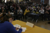 JOE080 As a cafeteria-full of students, friends and relatives wathc Arapahoe High School soccer...