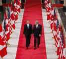 CAND117 - President Barack Obama and Canadian Prime Minister Stephen Harper walk down the Hall of...