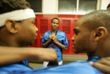 0280 Manual High School Thunderbolts' Jueleuis Judkins and his fellow teammates gather in the...
