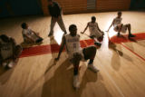 0124 The Manual High School Thunderbolts stretch before a game as they continue to rebuild the...