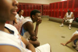 0224 Manual High School Thunderbolts' Donte Crews and his teammates listen to coach Lonnel Gordan,...