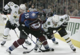 #55 Cody Mcleod fights for the puck in the 3rd  period as the Avalanche beat the Dallas Stars 3-2...