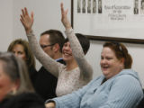 Students at Front Range Community College, Kelly Plefner signs applause seated with Kendra...