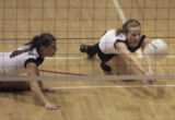 Chatfield's Emily Koenning,right, dives for the ball as teammate Hannah Segebart,left, looks on in...