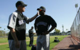 (0252) Tom Runnell talks with Eric Young at Colorado Rockies spring training at Hi Corbett Field...