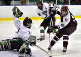 Cheyenne Mountain High School forward Trentt Houghton (right) took a shot on goal against Summit...
