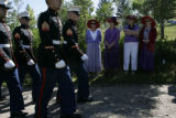 Mourners gather by the side of the road at Sunset View Cemetery as Lance Corporal Evenor Herrera's...