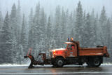 State of Colorado department of Transportation worker, Val Unrein (cq), drive his snow plow back...