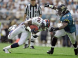 The Denver Broncos' Rod Smith (#80, WR) hauls in a pass in front of the Jacksonville Jaguars' Mike...