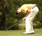 Nick Umholtz of Greeley Central H.S. reacts to a missed putt on the ninth hole during the Class 4A...