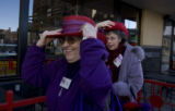 "The 'Radiant Rubies,"" women who wear red hats, Joan Ruch and Jackie Lorentzson (l-r) picked a..."